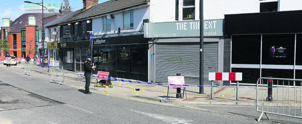 Officers cordoned off the area after the fight in Regent Circus in the early hours of Sunday