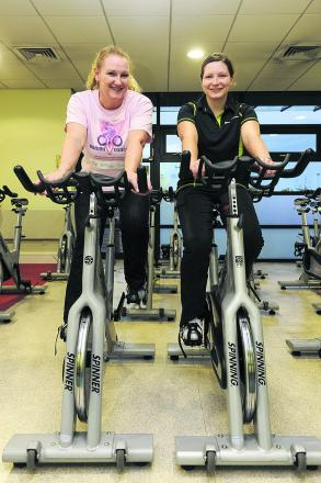 Michelle Bentham, left, and Faye O'Donoghue prepare for their 400km bike ride round Cuba