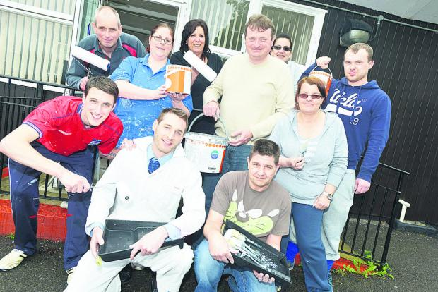Staff from Mid-counties Co-op who have been painting the community centre in Savernake Road
