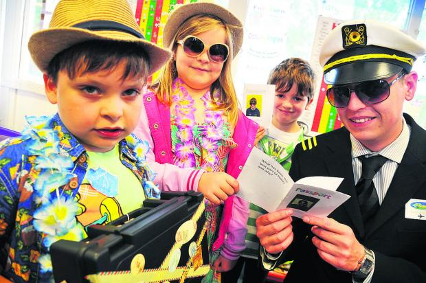 Westrop Primary School, Highworth, was transformed into an international airport for the day as part of a week looking at other countries and cultures. Teacher turned pilot Daniel Adams is pictured with the pupils