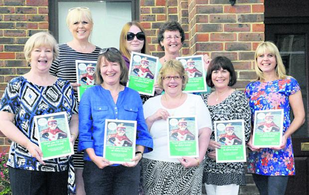 The NSPCC volunteer heroes. Back row, from left, Heather Coates, Pippa Norman, Marilyn Kempshall. Front , Linda Jones, Anne Norman, Dawn Boyle, Daphne Helyer, Helen Meade