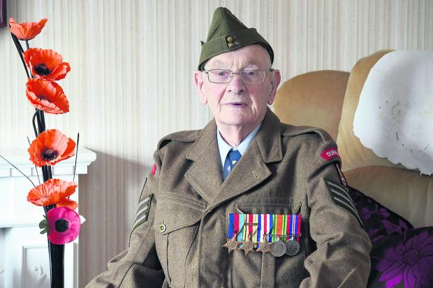 Veteran Ken Scott gets all spick and span ready for his memorable reunion with  fellow soldiers for the 70th  anniversary of D Day