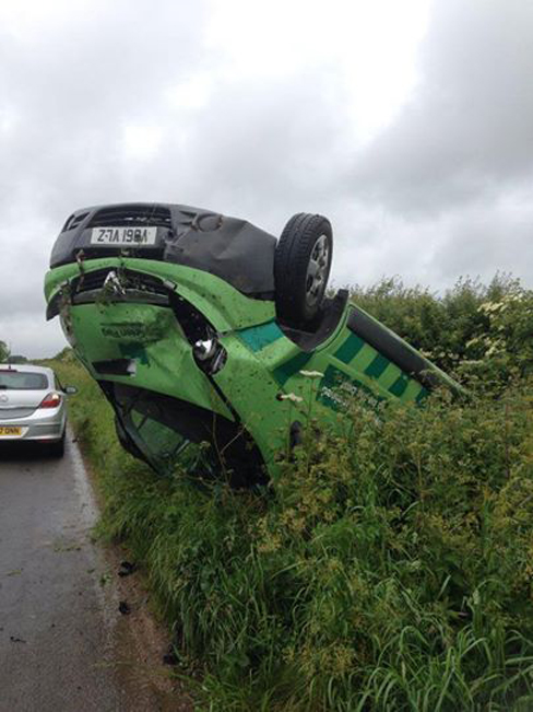 Driver's lucky escape after flipping onto roof