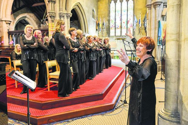 Sheila Harrod conducting the choir (from Swindon Advertiser)