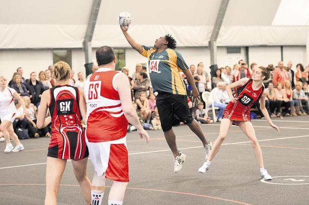Colyn Gordon of the England Men team in action during an exhibition game against Hucclecote at the Squires Netball Tournament