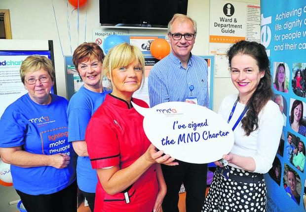 Doctors and nurses will sign a motor neurone disease charter setting out what they aim to do for patients at GWH. Left to right are  Barbara Crook, Alison Aviss, Julie Marsham, Graham Lennox and  Elizabeth Price
