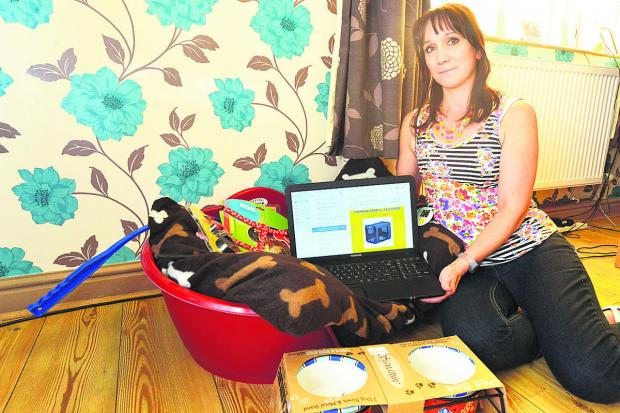 Swindon Advertiser: Julie-Anne Morrisey with the bed she had ready for her new dog, displays the site on which she was conned
