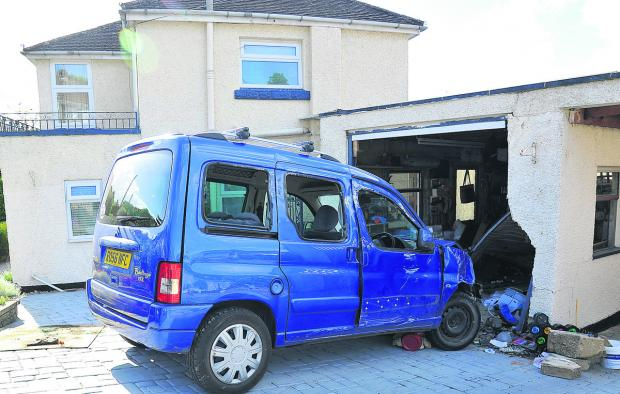 The car which smashed into Judy and Basil Jones' garage in Grosvenor Road