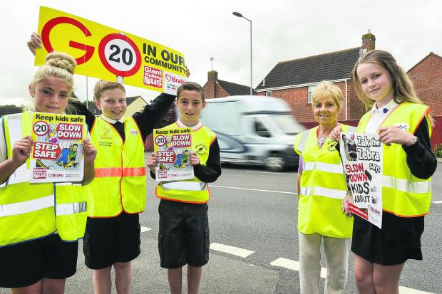 Pupils from Haydonleigh Primary School take to the streets to promote road safety. From left, Eve Hackman, Cameron Clements, Jarvey Richards, senior teaching assistant Debbie Yockney and  Hattie Bulpitt