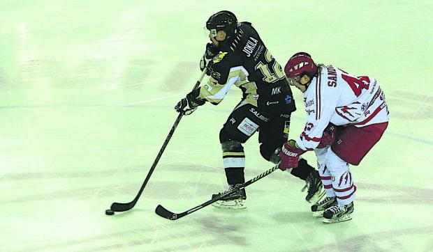 Swindon Wildcats' Henri Sandvik closes down a Milton Keynes  opponent during a match in March
