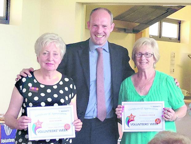 Pam Baker and Glenise Gough are presented with their certificates by Swindon North MP Justin Tomlinson