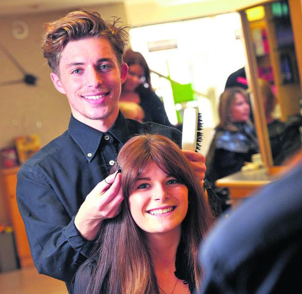 Joshua Goldsworthy, pictured styling Danielle Sealey's hair, is making waves in the world of hairdressing
