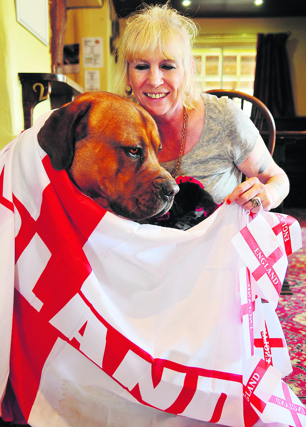 Cathy Kelly, landlady of The Baker's Arms, with four-legged fan Buddy