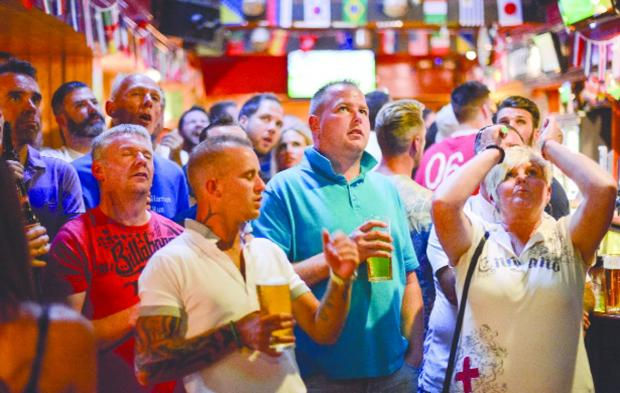 Swindon Advertiser: Disappointment among the crowd gathered at the Steam Railway pub in Old Town as England miss a clear shot on goal Pictures: Alex Skennerton