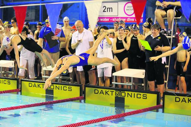 Former Swindon Tigersharks swimmer Jazz Carling in action at a Wiltshire league swimming meet