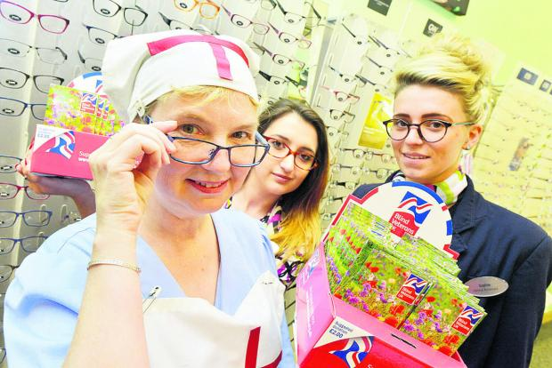 Debbie Fairfoull, Sophie Jones and Sarah Spratley fundraising at Specsavers for Blind Veterans. Picture: THOMAS KELSEY