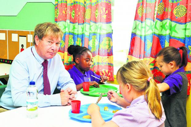 Goddard Park headteacher Mike Welsh having lunch with pupils