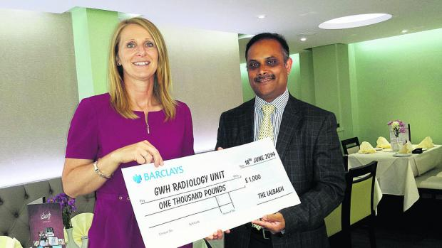 Jen Green, the head of fundraising at the Great Western Hospital, and Abdul Amin, owner of Lalbagh in Rodbourne Road