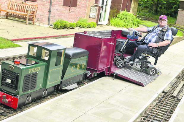 Allan Wells tries out the new carriage. Picture: ALEX SKENNERTON