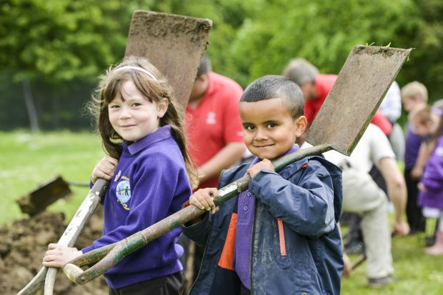 Children at Goddard Park dig a trench as part of their commemoration of the First World War