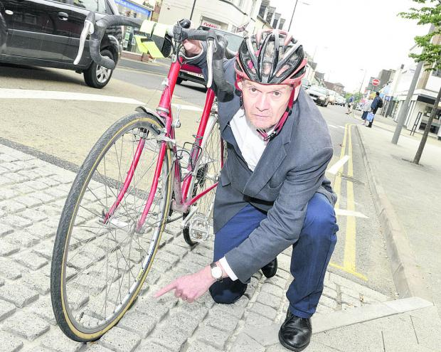 Martin Jones, who is  concerned about the cobbles at the new Regent Circus development after his bike tyre got stuck in them