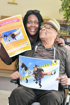 Stella Edwards and her father Sammy promoting her skydive.  Picture: Alex Skennerton