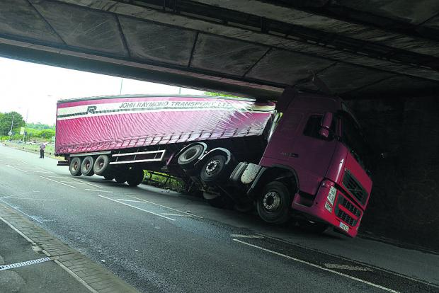 The lorry stuck under Wootton Bassett Road bridge yesterday. Picture: THOMAS KELSEY