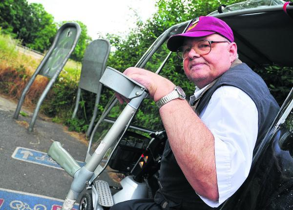 Allan Wells, whose mobility scooter can't get along the path at Coate Water due to the high metal barriers