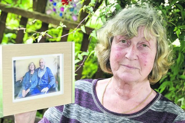 Wendy Curtis with a photo of her brother Glynn Uzzell who died in a gas explosion at his home in Portugal