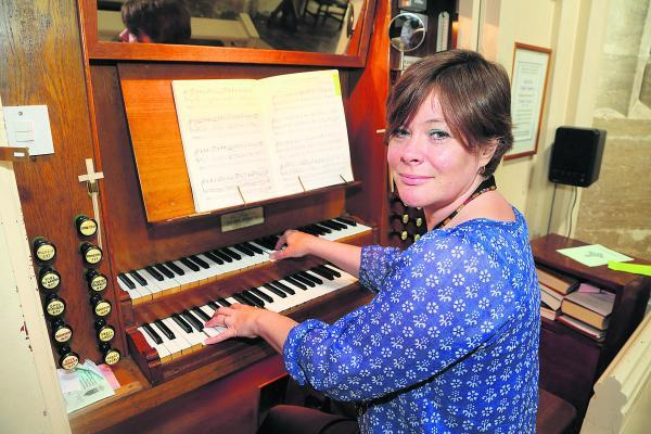 Sarah Townsend, the director of music for St Sampson's Church plays the organ which has been damaged by bat droppings