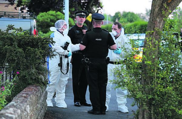 A forensics team at work at the scene of the arrest at Southbrook Street extension