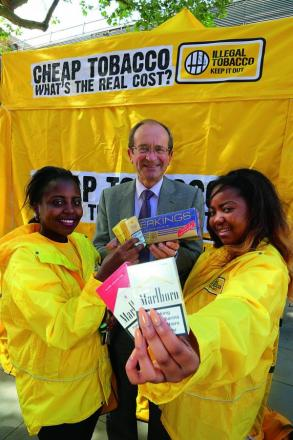 Smokefree event team members Debra Mumbi-Peterson and Tianna Esson pictured with Swindon council deputy leader Brian Mattock