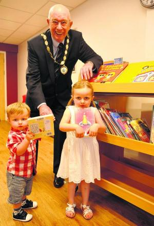 Parish council chairman John Foley at Grange Leisure Centre's new library with  Oliver and Ava Godwin
