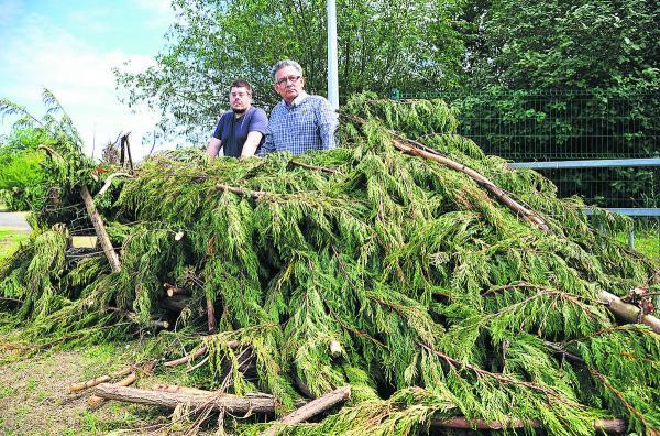Neil Heavens and Derique Montaut, councillors for Liden and Eldene, with garden waste believed to have been fly-tipped outside Liden School
