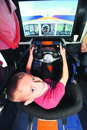 Lewis in the cockpit of Intel's Bloodhound at Churchfields Academy. Picture: THOMAS KELSEY