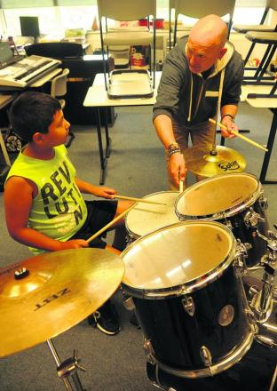 Andreas Juan is taught drumming by Martin Ranscombe