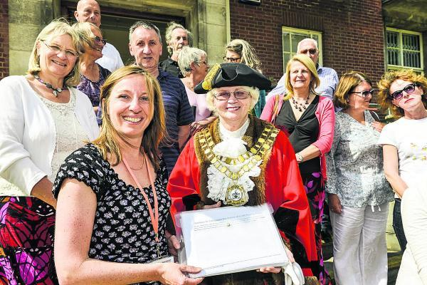 Old Town councillor Nadine Watts handing a petition for Croft Fields to Mayor Teresa Page
