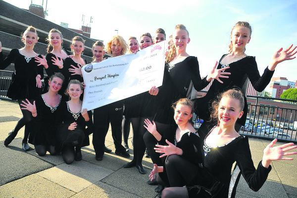 Tanwood School's fundraising chorus line with a grand £1,000 cheque for the 160 Appeal