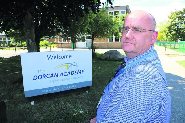 Simon Neads, the assistant headteacher at Dorcan Academy where staff have been warning pupils about a man possibly stalking girls near the school