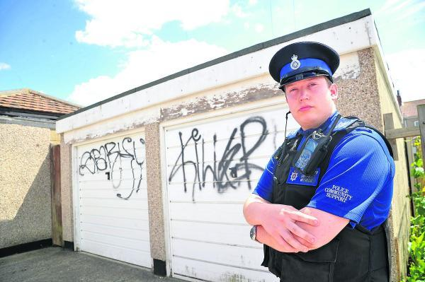PCSO Andy Dellar with some of the new graffiti appearing  in Gorse Hill