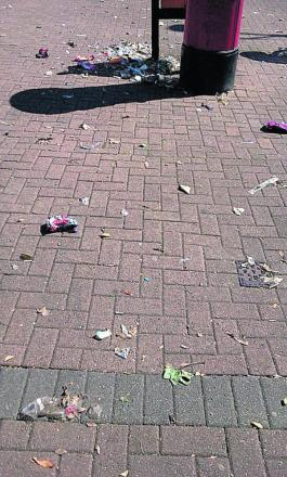 Sussex Square with litter strewn around