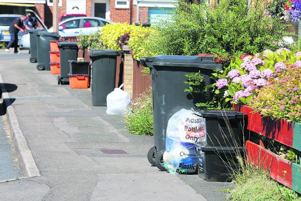 Bins in Moredon, which were not emptied yesterday  because of strike action