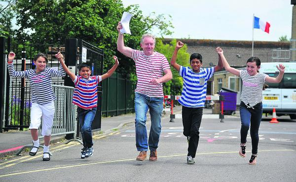 Celebrating Holy Rood School's good Ofsted report are Anais, Fanson, headteacher Tony McAteer, Myron and Summer