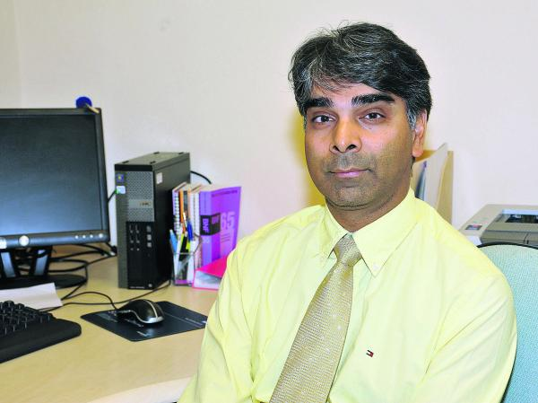 Freshbrook Surgery is planning to reduce it's opening hours. Pictured: Dr Amit Dwivedi