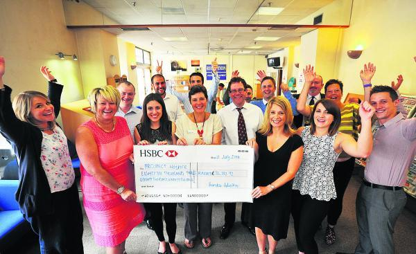 Swindon Advertiser: The Adver team hand over the cheque to Prospect chief executive Angela Jordan, c