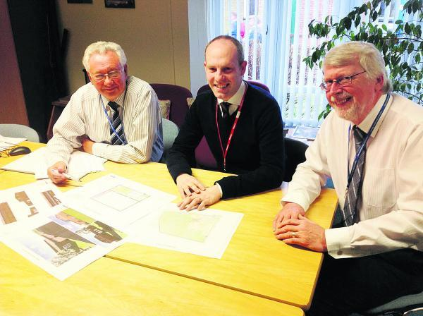 From left, Warneford School governor Malcolm Holbrook, MP Justin Tomlinson and headteacher  John Saunders looking at the plans for the new sports centre