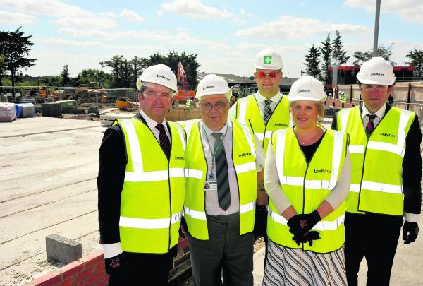 Work has begun on the new affordable extra care housing scheme in Cloatley Crescent, Royal Wootton Bassett. From left, locality manager Paul Tewkesbury, Coun Keith Humpheys, contract manager Matt Sidwell, Victoria Smith of Wiltshire Council and property d