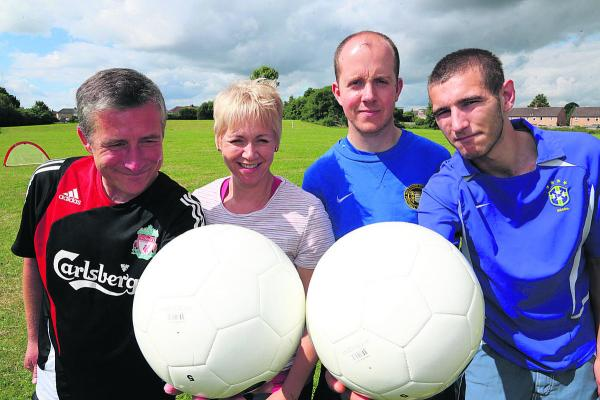 Members of Threshold in Swindon playing football to help them with confidence development. From left, Jason le Feuvre, positive activity worker Donna Harris, Tim Hall