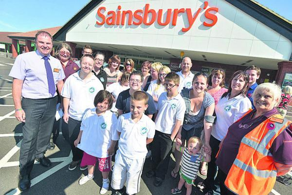 Members of Swindon Down's Syndrome Group and Sainsbury's Bridgmead staff