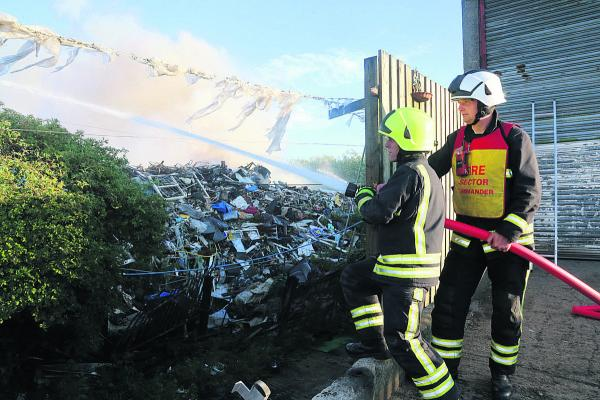 Fire crews battle through the night to tackle waste firm blaze